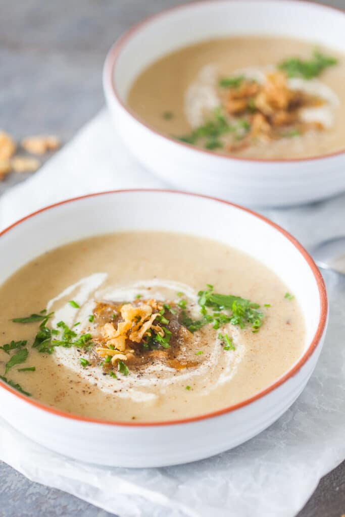 This cauliflower soup is not your regular dish. Using roasted cauliflower and caramelized onions it is a hearty soup for cold days.