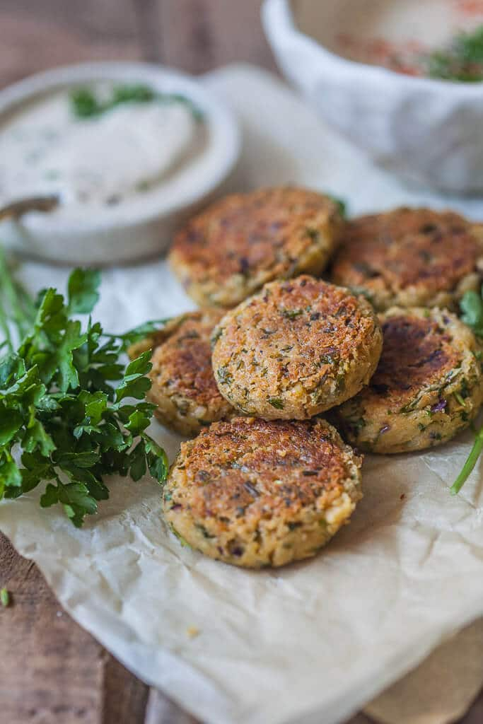 This Pan Fried Falafel is a healthier twist on the classic recipe with fewer calories, but plenty of taste. An easy 30-minute lunch idea! | www.vibrantplate.com