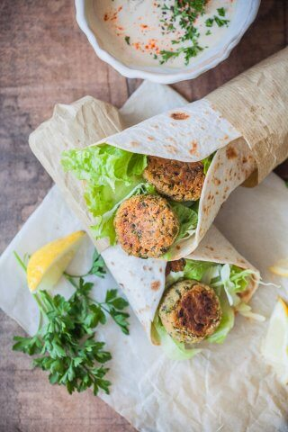 The Easiest Lemon Tahini Falafel Wrap, topped with a delicious Lemon Tahini Sauce is a quick & vegan meal. | www.vibrantplate.com