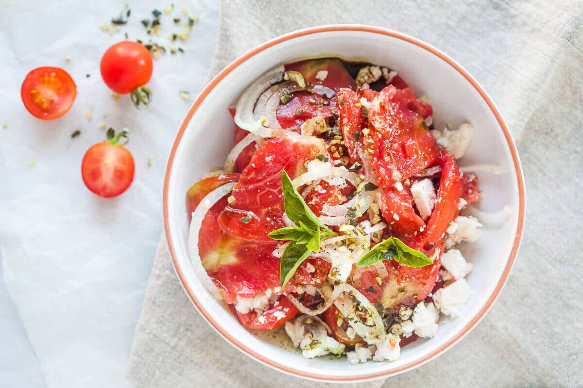 Tomato Salad with Feta Cheese, Onion and Pumpkin Seed Oil