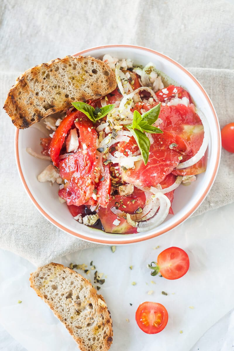 Tomato Salad with Feta Cheese, Onion and Pumpkin Seed Oil.