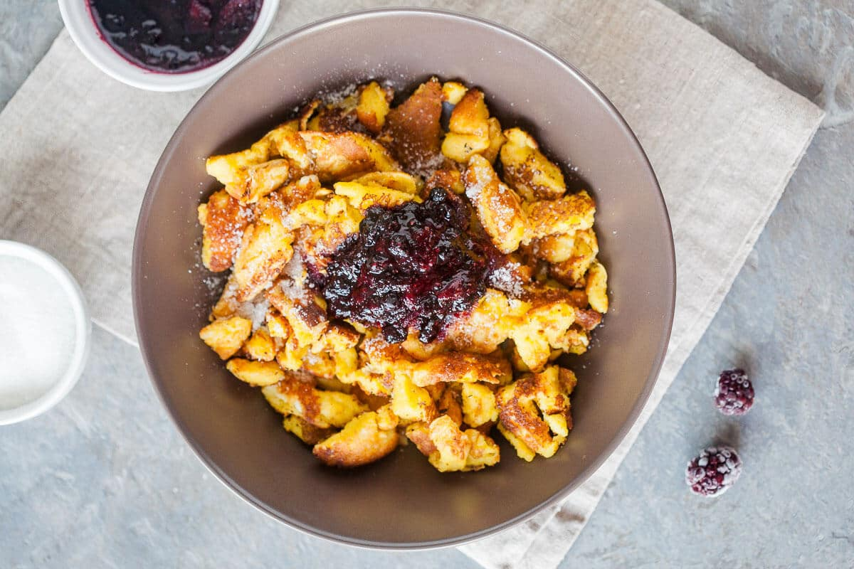Kaiserschmarrn is a breakfast favorite shredded pancake. Light and fluffy you can also enjoy it for dinner! | www.vibrantplate.com