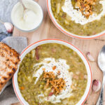 This Split Pea Minestrone Soup is a rustic winter comfort food that will warm you up on a cold day. Skip bacon for a vegetarian option! | www.vibrantplate.com