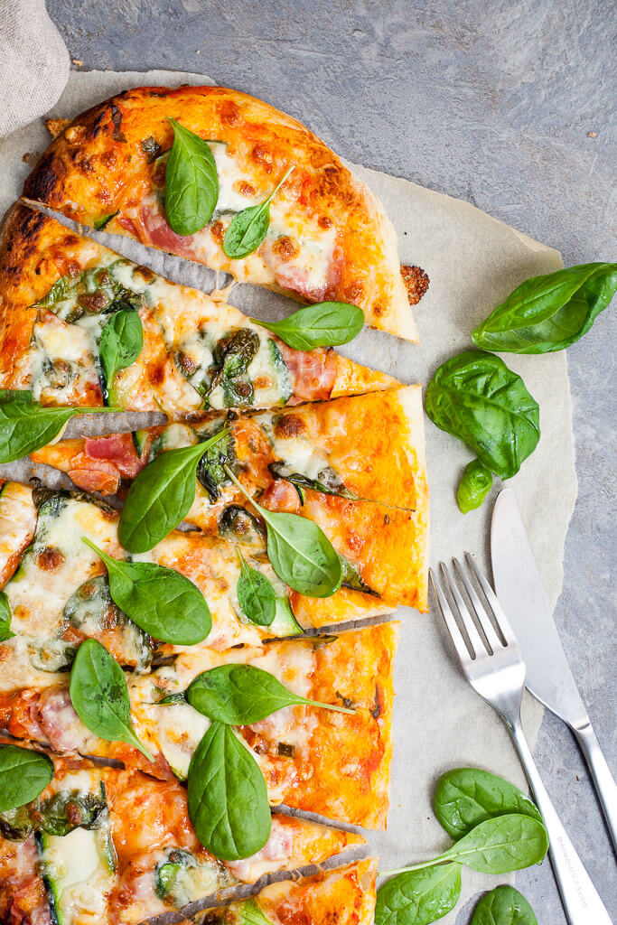 This delicious Spinach & Zucchini Spelt Flour Pizza is made with spelt flour, ham, zucchini and spinach for a healthier pizza option. | www.vibrantplate.com