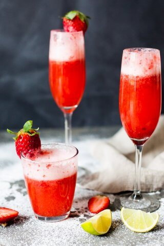 Celebrate Valentine's with this easy & delicious Strawberry Champagne! Mix champagne with strawberry puree for a delightful drink.   www.vibrantplate.com