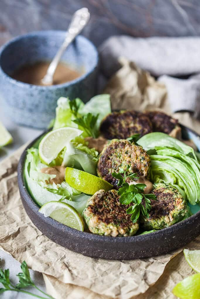 Tofu Zucchini Fritters with Peanut Sauce is the perfect way to use up all those zucchinis.   www.vibrantplate.com