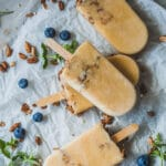 Vegan Peach Smoothie Popsicles are made from frozen leftover smoothie. An easy and delicious summer treat! | www.vibrantplate.com