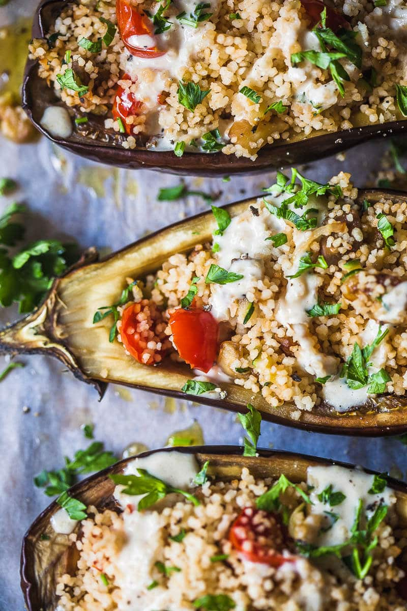 Couscous Stuffed Eggplant topped with a fresh Lemon Tahini Sauce is a delicious way to serve eggplants. Vegan and Dairy-Free! | Vibrant Plate