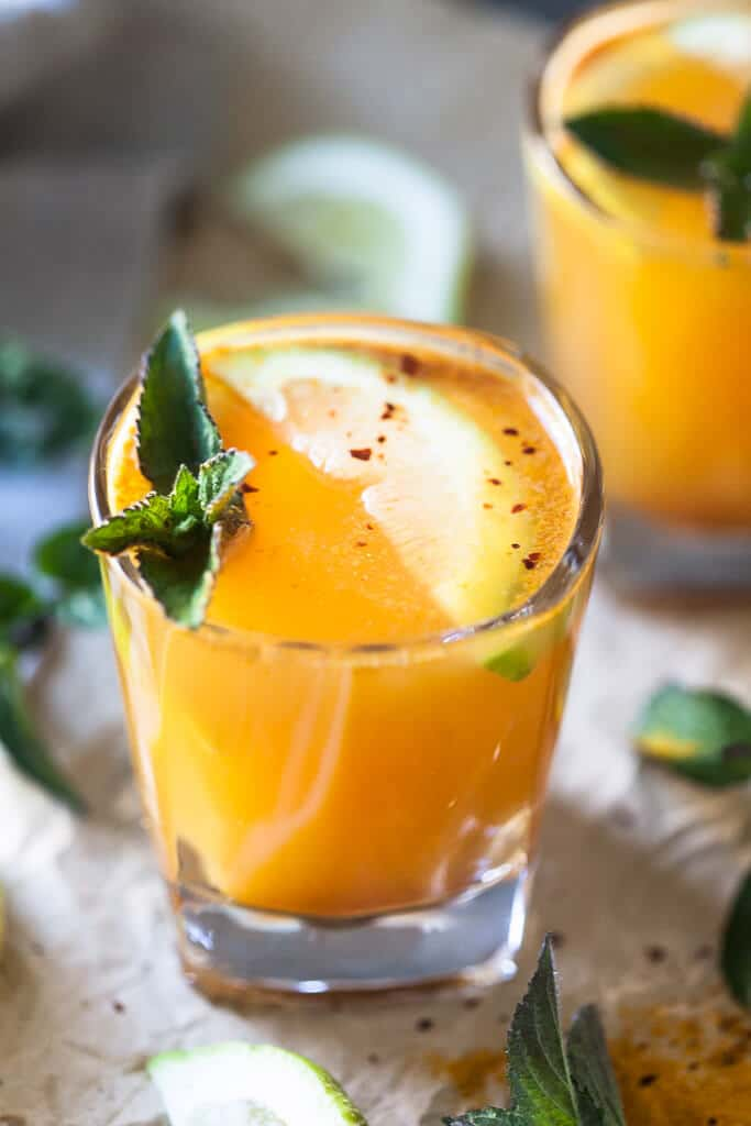 Yellow Glow Energizing Water with Turmeric, Ginger, Cinnamon, and Chili to help you boost your immune system.   Vibrant Plate