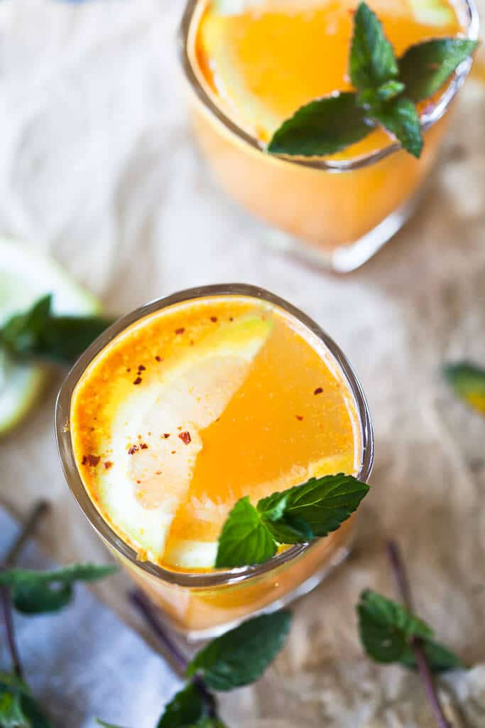 Yellow Glow Energizing Water with Turmeric, Ginger, Cinnamon, and Chili to help you boost your immune system. | Vibrant Plate