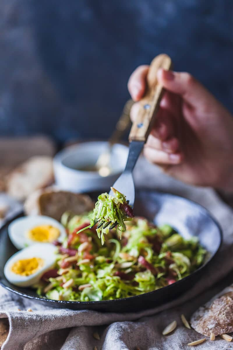 Not your standard salad, this Brussels Sprout Salad with Bacon and Eggs is a fresh take on the humble vegetable. | Vibrant Plate