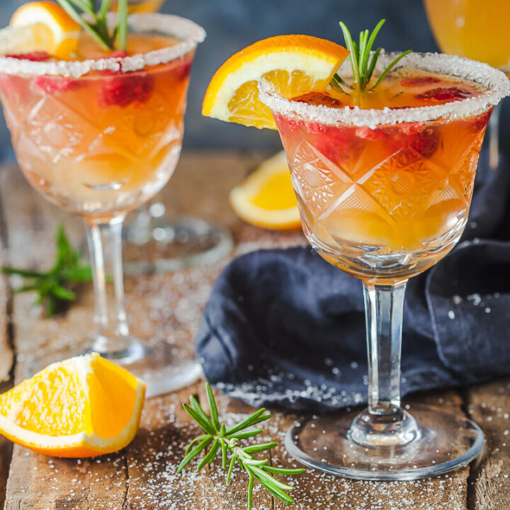 An excellent brunch drink, this Orange Raspberry Mimosa Cocktail is the perfect fit to celebrate the arrival of spring! | Vibrant Plate