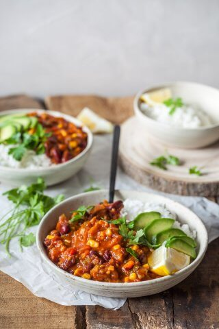 This Easy One-Pot Spicy Vegan Chili is packed with vegetables and ready in just 30 minutes. The perfect winter comfort food!   Vibrant Plate