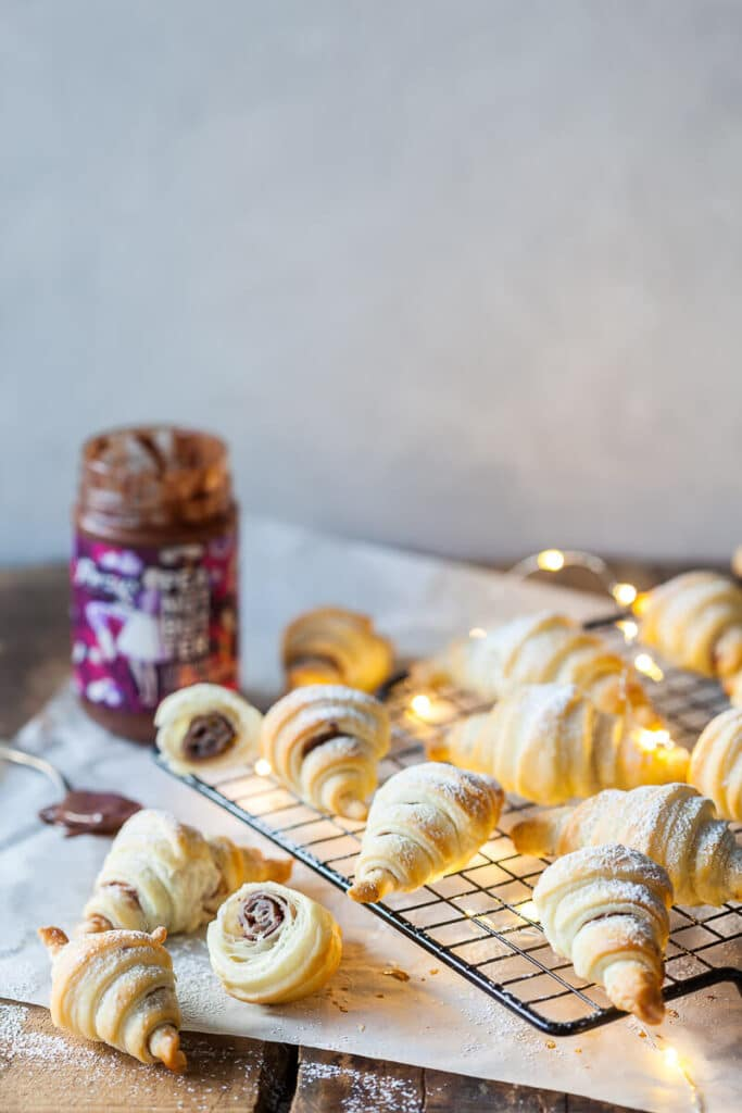 Peanut butter croissants on a cooling rack