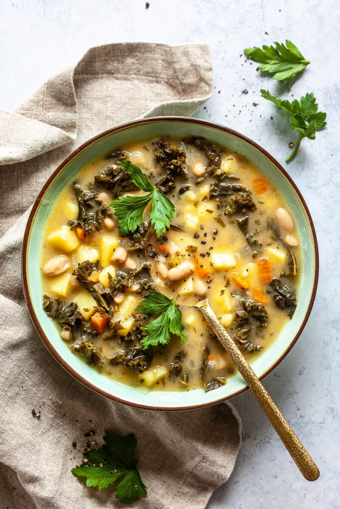 Vegan White Bean and Kale Soup on table